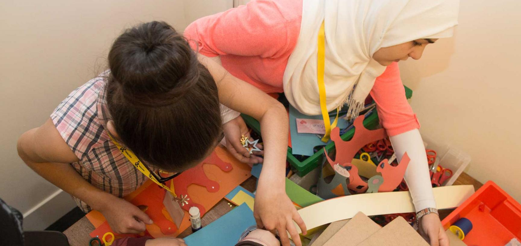 two girls making crafts at family day