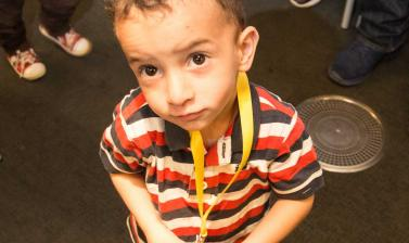 little boy at family day, looking at the camera