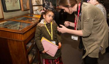 child talking to museum staff