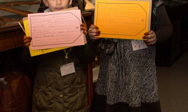 Children in museum with own labels for objects