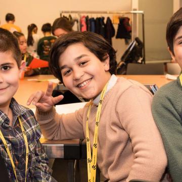 3 boys smiling at the camera